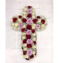 Croix de rose rouge et pastel